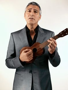 George Clooney Plays the Ukulele  :: barely, hardly, not really... but it's George  ( video ::  http://www.facebook.com/l.php?u=http%3A%2F%2Fwww.thedailybeast.com%2Fvideos%2F2012%2F01%2F26%2Fnewsweek-ipad-app-exclusive-video.html&h=FAQETnNLG  )