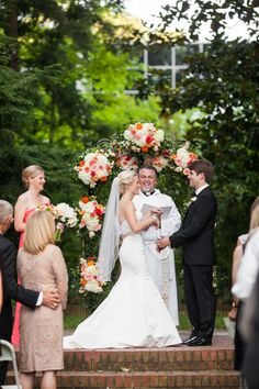 fled de lis arch with florals of white hydrangea, roses, and all SMILES!!!!
