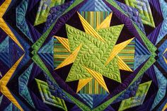 Pieced by Jo Ann Kilgroe. Freehand machine Quilted by Jessica's Quilting Studio