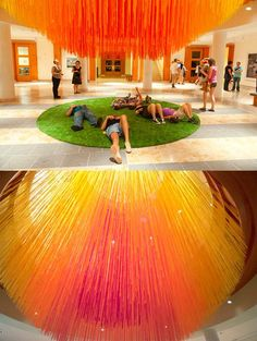 """Eric Rieger aka HOT TEA recently put up this really amazing installation at the Minneapolis Institute of Arts entitled Letting Go. Using 84 miles of colored string, Letting Go is the artist's interpretation of the sun.    """"At least once in our lives we have all had to let go of something we truly love. Whether it be a pet, personal object or in some cases, loved ones. This piece is my interpretation of the sun. The sun brings life and also represents happiness, warmth and energy. When"""