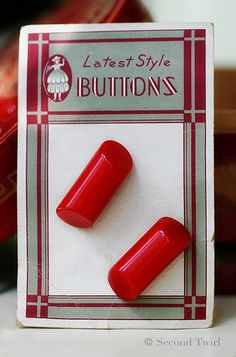 Rich red vintage Bakelite buttons on original card.