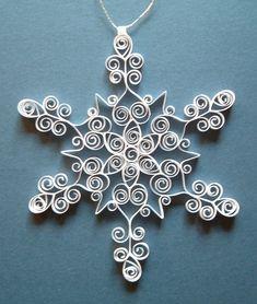 Awesome quilled snowflake ornament