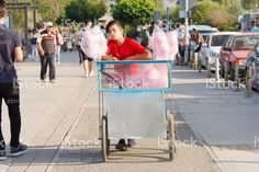 A Boy Is Selling Cotton Candy With His Handcart royalty-free stock photo