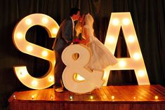 photo of giant marquee letters for wedding reception backdrop