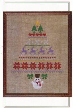 Easy Christmas Cross Stitch Patterns  via Etsy.**Like the borders for under the name and the toe?!