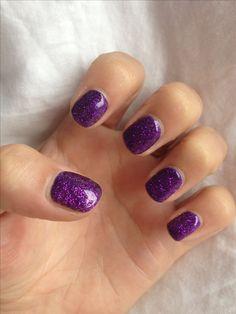 Purple Shellac nails.