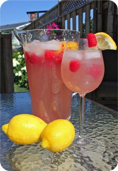 PINK LEMONADE SANGRIA: 1 can of frozen pink lemonade concentrate 500 ml of sugar free lemon fresca 1 750ml bottle of white wine (pinot grigio or riesling) raspberries lemons