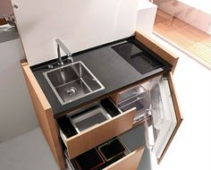 It may be small, but Kitchoo's Cuisine K1 packs a punch in the form of an integrated fridge-freezer, 2-burner cooktop, induction oven, telescopic mixer and a sink. You can even get an integrated dishwasher and/or trash compartment as optional add-ons. When closed it's as simple as can be, all pale wood finishes with no visible hardware.