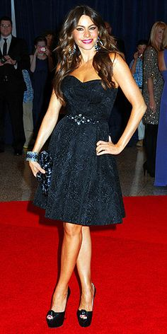 SOFIA VERGARA  Though she's usually partial to fitted mermaid styles that flaunt her famous curves, the bombshell instead puts the emphasis on her stems in a David Meister Signature mini featuring a sweetheart neckline and jeweled waistline, then adds massive platform stackers and chandelier earrings.