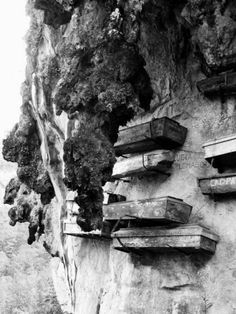 """Hanging coffins are coffins which have been placed on cliffs. They can be found in various locations, including China and the Philippines. In China, they are known as Xuanguan which also means """"hanging coffin"""".  Hanging coffins are an ancient funeral custom of some minority groups, especially the Bo people of southern China. Coffins of various shapes were mostly carved from one whole piece of wood. Hanging coffins either lie on beams projecting outward from vertical faces such as mountains…"""