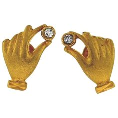 Unique and finely designed yellow gold hands holding diamonds earrings. Made of yellow gold, these hands are holding precious white round diamonds Diamonds And Gold, Round Diamonds, Hand Jewelry, Hand Holding, Gold Hands, Diamond Earrings, Jewels, Unique, Porn