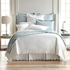 $36  twin coverlet.  available in light brown, light gray, light blue, and white.
