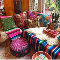 Bohemian style furniture items are not easily available in stores. It's all your hard work that turns the ordinary furniture into outstanding and fulfilling the terms of boho style. The appealing boho style layering of the room shown below, will deliver a boho vibe to you and of, course to your guests.