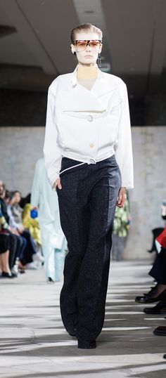 LOEWE Autumn Winter 15 look 7. Cross waistband trousers-wool/elastane-black / Fencing jacket-cotton-white / Skin turtle nack sweater-wool-almond / Filipa sunglasses-acetate-havana-transparent / Ibiza earring-silver-rhodium / Small leaf earring-silver-black / Small leaf earring-silver-gold / Column ring ankle boot-calf-goatskin-navyblue-multicolor