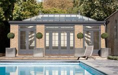 This orangery style pool house and compliments the pool perfectly. Westbury Gardens, Simple Pool, Pool Shower, Hot Tub Garden, Blue Ceilings, Gothic House, Pool Houses, Beach Houses, Exterior Design