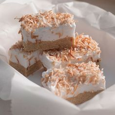 This slice with its layers of whipped marshmallow and toasted coconut is like floating on a cloud of sweet vanilla air under a palm tree. Seriously, you need to make it. Coconut Recipes, Baking Recipes, Cake Recipes, Dessert Recipes, Baking Ideas, Coconut Slice, Toasted Coconut, Yummy Treats, Sweet Treats