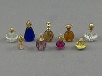 cute perfume bottles made with gold by Don Henry, sold through the Little Dollhouse Company: