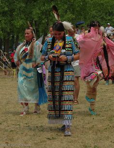 Jingle dress dancer ,text break by Rick Brady. Kahnawake Pow Wow 2012 .