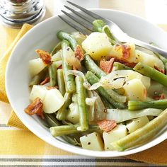 Easy Beans & Potatoes with Bacon Recipe -I love the combination of green beans with bacon, so I created this recipe. When you have company, you can start the side dish in the slow cooker and continue preparing dinner...or visit with your guests! —Barbara Brittain, Santee, California