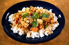 Slow Cooker Chicken Curry is full of root vegetables, chickpeas, green peas, and creamy coconut milk. Tender chicken and curry, cumin, and cilantro add to the deliciousness of this easy dish.