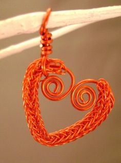 The Crafty Geek: I'd had this idea a while ago, and Valentine's Day seemed to be the best time to give it a try. First I made a section of Viking knit enamel coated wire. Then I threaded a thicker wire through the middle and shaped it into the heart. It's an adorable small pendant or large charm!