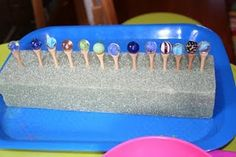 fun fine motor: place golf tees in a styrofoam block (or have children do this as part of the activity), balance marbles atop the tees
