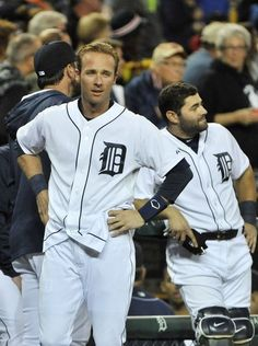 Tigers' Andrew Romine looks over as the umpires go