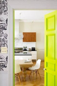 Unexpected interior door color: neon yellow welcomes you to a happy kitchen