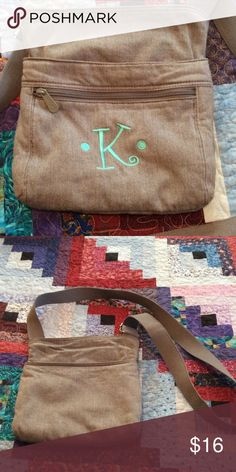 Thirty-One heather gray cross-body Great used condition Thirty-One gray cross body purse with turquoise 'K' embroidered on front. Has been washed. Great pockets! 👀 Kim, Kylie, Khloe, Kendall, Kourtney, Karen, Kay, Krystal, Kim, Kendra, or Kandi, would love this one!! 👀 Thirty-One Bags Crossbody Bags