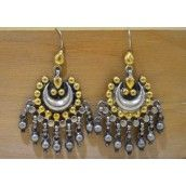 Two tone dangle earrings in golden and silver color. Jewellery made from pure silver metal and gold plating.
