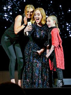 Thursday, March 31, 2016 | LOVE YOUR SELFIE | Dreams do come true! Adele snaps a pic with two lucky fans during her concert in Birmingham, UK