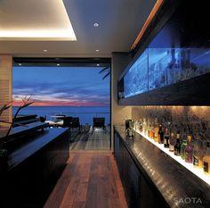 Home Bar, views, wooden floors, wooden bar counter, fish tank feature on wall, down lights