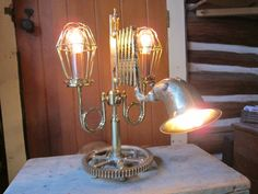 The Inventor's Lamp a 3 way scissor arm table lamp by WillRockwell, $400.00