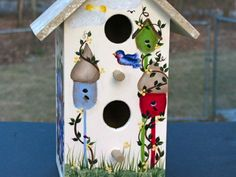 Birdhouse's on one.  One Stroke Painting by Susan Earl.