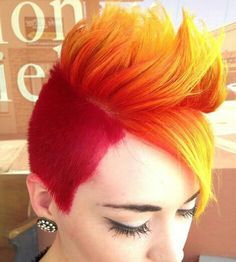 Red and yellow side shaved side swept bangs dyed pixie hair cut