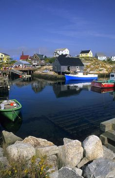 Village of Peggy's Cove with harbor and fishing sheds in Nova Scotia, Canada. Photo: Danita Delimont