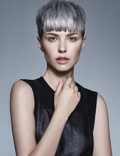 Looking for short hair inspiration? This short crop with fringe still has a little length and texture to play with, so is perfect for a bold colour to create a standout style. We love the silver grey tone with hints of icy blue. From Francesco Group's 2016 Collection.