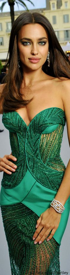 Irina Shayk. Skanky -- too revealing, too low. High fashion never stoops to overt sexual attention-seeking gimmicks.