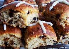 Confession: I've never eaten a hot cross bun made with wheat flour. But from all accounts, hot cross buns are like slightly sweet, fruit-filled dinner rolls. Traditional recipes call for raisins or...