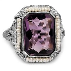The Vittoria Ring from Brilliant Earth The beauty of a radiant cut amethyst is highlighted by thirty-seven seed pearls strung on wire around it in this stunning Edwardian-era ring. The lavishly detailed gallery features bow and flower designs (approx. 6.50 total carat weight).  Date:  1910's.
