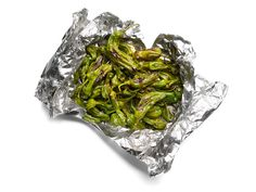 Grill in Foil - Shishito Peppers     Toss 1/2 pound shishito or Padrón peppers, a drizzle of olive oil and 1/4 teaspoon paprika on a sheet of foil. Form a packet. Grill over medium-high heat, 7 minutes. Sprinkle with coarse sea salt.