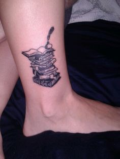My tattoo! A stack of books on my ankle.