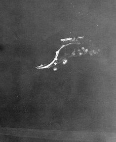 Aerial view of Japanese carrier Ryujo, which was sunk by aircraft from carrier USS Saratoga during the Battle of the Eastern Solomons, 24 Aug 1942. (US National Archives)