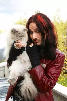 Tuomas Holopainen from Nightwish and his paws in his game.