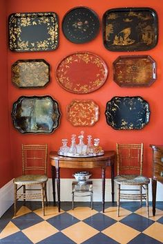 Hang decorative TRAYS on Wall. GREAT for KITCHEN, DINING ROOM or BREAKFAST NOOK area. There are TONS for CHEAP in Dollar Stores and Thrift Stores. Happy Hunting !