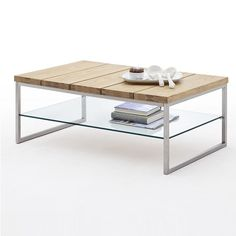 Milton Coffee Table In Knotty Oak With Clear Glass Undershelf And Stainless Steel Frame, This Combination of Glass Wood And Metal Makes it Elegant piece of furniture. Finish: Knotty Oak, Clea...