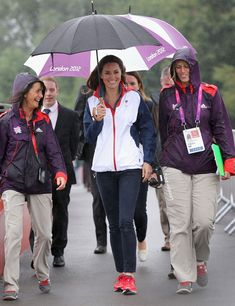 Catherine, Duchess of Cambridge arrives in the rain at Eton Dorney for the rowing on day 4 of the London 2012 Paralympic Games at Eton Dorney on September 2, 2012 in Windsor, England.