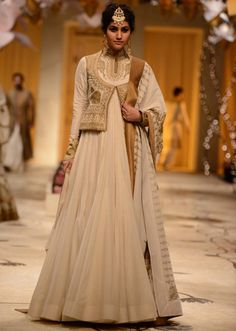 Model walks the ramp in cream floor length anarkali matched with waist jacket  for Rohit Bal at Indian Bridal Week 2013