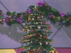 Learn how to make a beaded Christmas tree, a simple decorative stand, and beaded ornaments to hang on the tree at DIYNetwork.com.