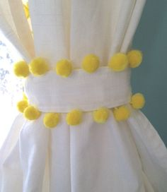 Add some fun to any room!  White, cotton curtain with yellow pom pom trim. Machine washable.  Available in most sizes, colors. Curtain fabric